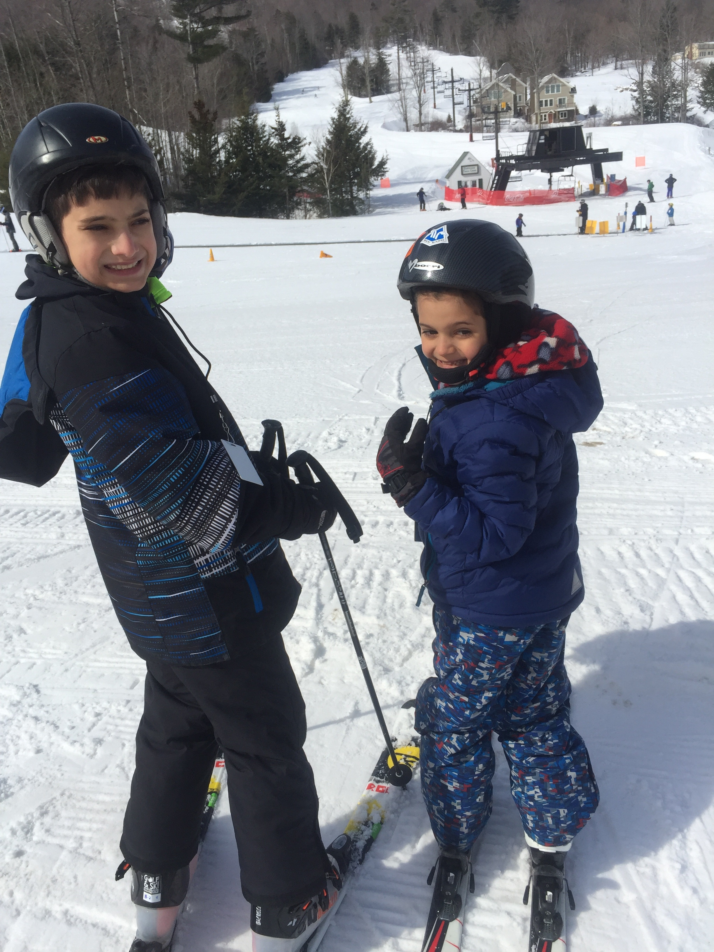 Two boys skiing family skiing location independence families www.thethreeyearexperiment.com