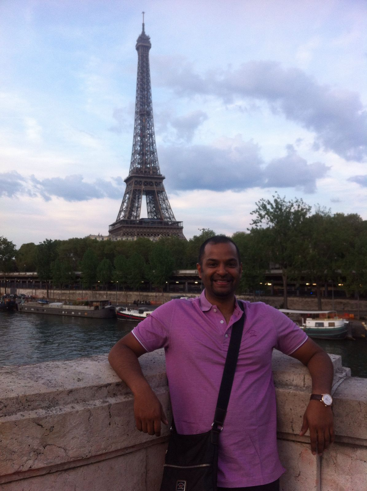 Jonathan in front of the Eiffel Tower---www.thethreeyearexperiment.com
