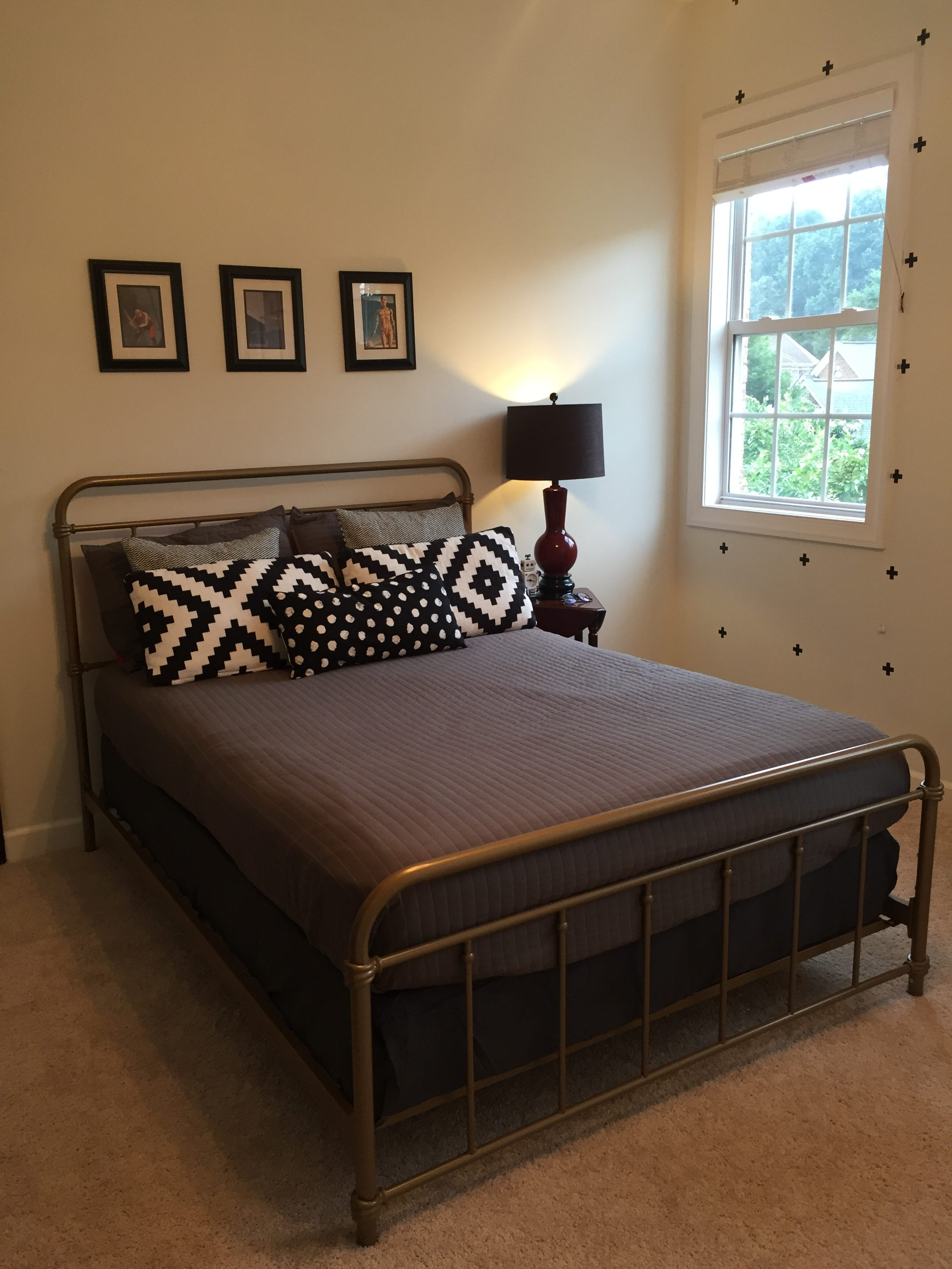 The new bed, bed linens, bedskirt, and pillows.