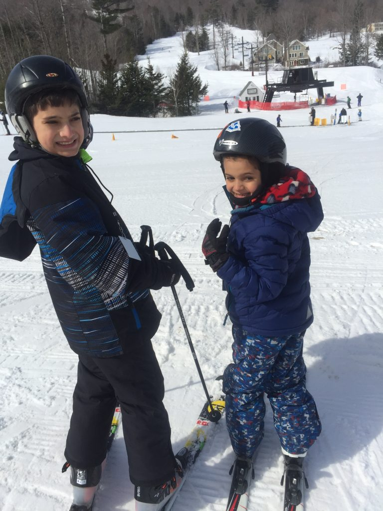 Two boys skiing family skiing www.thethreeyearexperiment.com