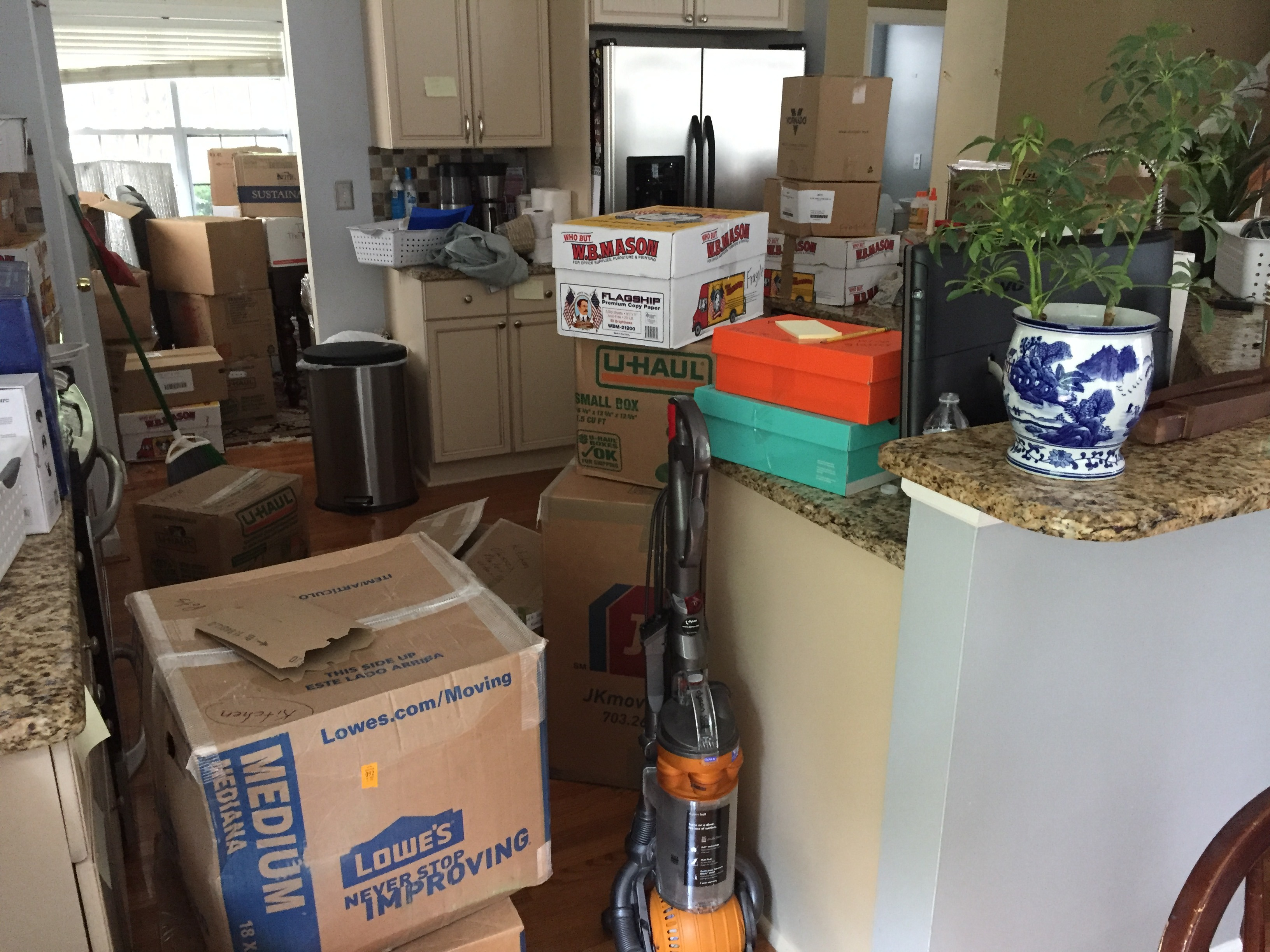 Moving boxes all over the house www.thethreeyearexperiment.com