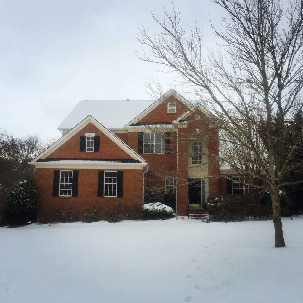 Our house in North Carolina snow www.thethreeyearexperiment.com