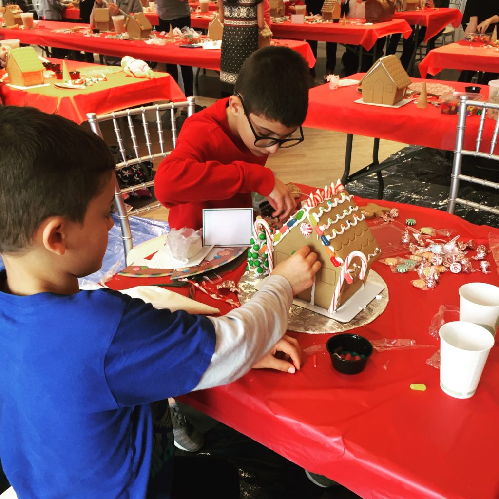 Decorating gingerbread houses www.thethreeyearexperiment.com