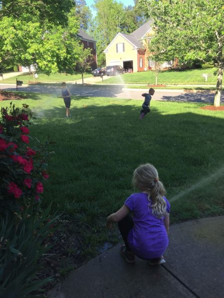 Kids playing sprinkler April Net Worth www.thethreeyearexperiment.com